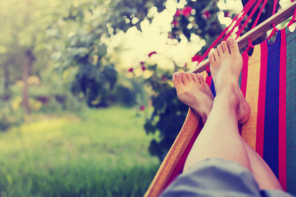 Person relaxing in a hammock in their garden