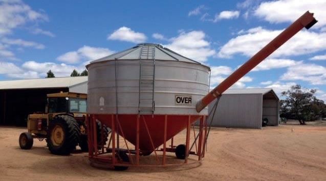 Portable field bin attached to a tractor