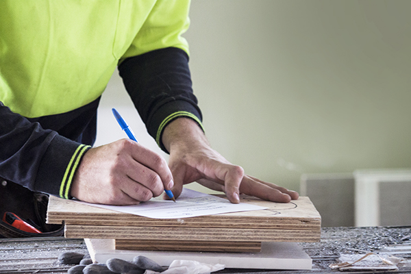 Construction worker completing paperwork