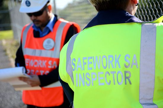 Two SafeWork SA Inspectors in hi vis jackets
