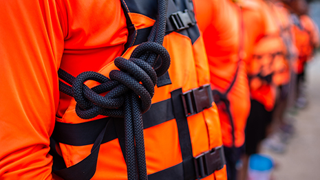 A close-up of a person wearing a life jacket